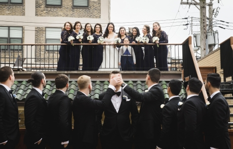wedding at lang house chicago outdoor deck bridal party